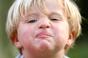 Young boy's face with stubborn expression