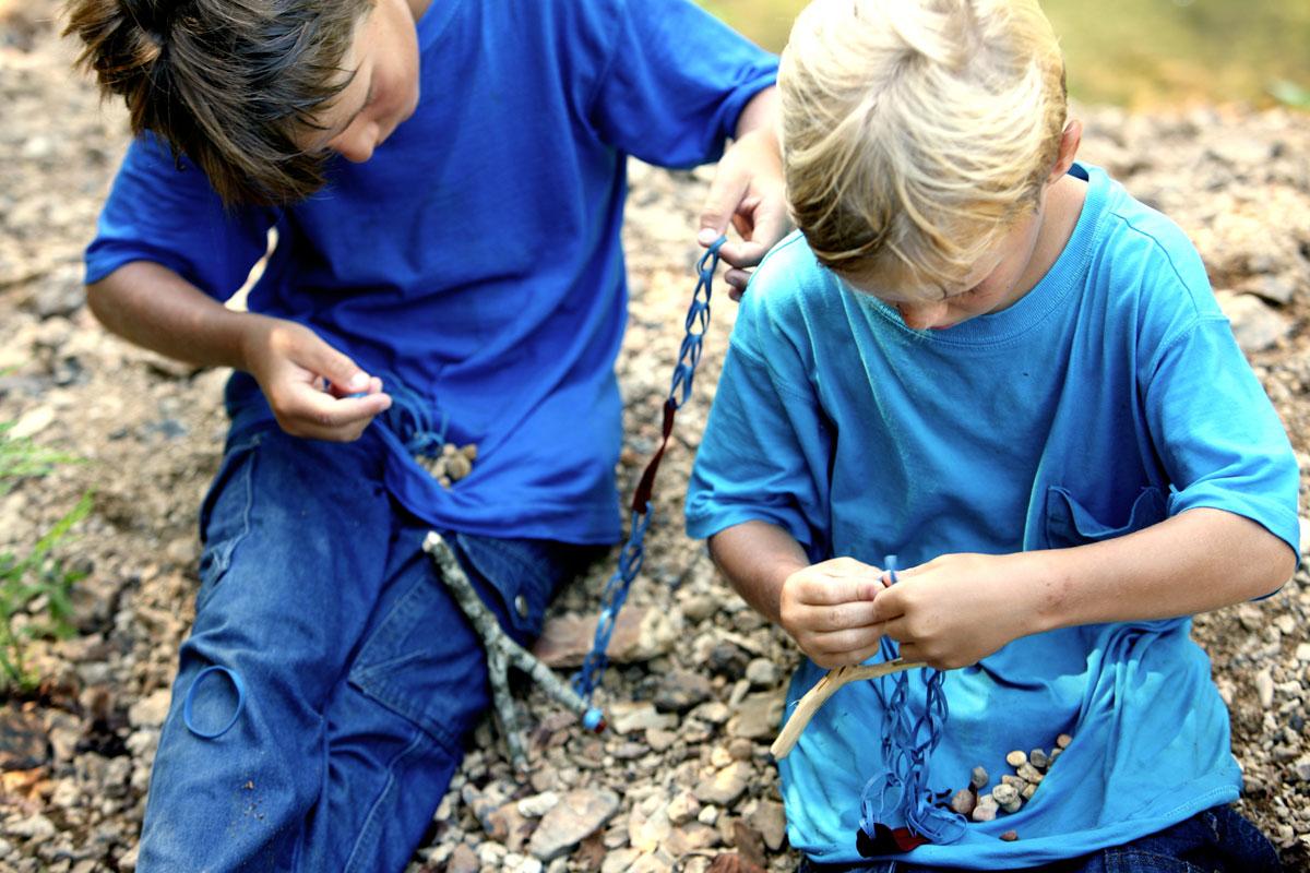 Boys making slingshots