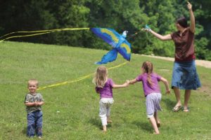 Mother and children flying a kite